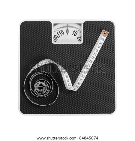 Old bathroom scale with measuring-tape. - stock photo