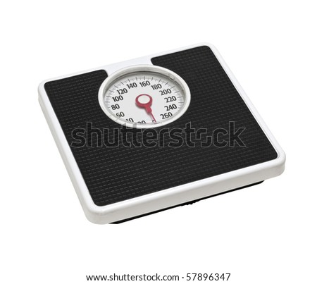Old bathroom scale.  Worn from many years of dieting. - stock photo