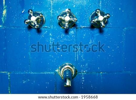 Old Bathtub on blue wall - stock photo