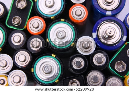 old batteries on white background - stock photo
