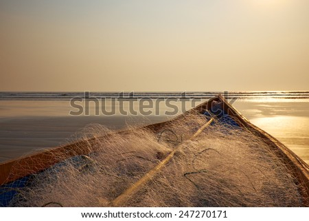 Old beached fishing Boat - Asian Style - stock photo
