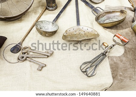 Old beater and keys, detail of some old keys and kitchen tools - stock photo
