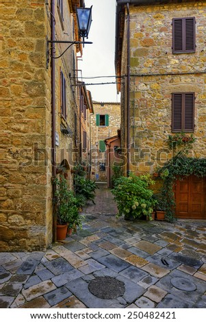 Old beautiful city in the sun of Tuscany, Pienza, Italy - stock photo