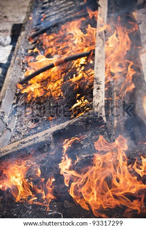 old bed be in the fire - stock photo