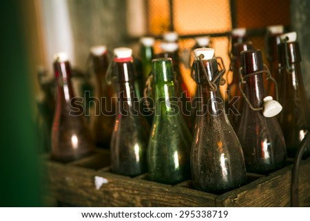 Old beer bottles in wooden cases - stock photo