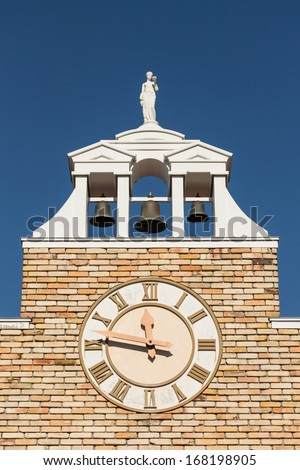 Old bell tower clock  at a church - stock photo