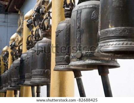 Old bells in a buddhist temple of Thailand, Chiang Mai - stock photo