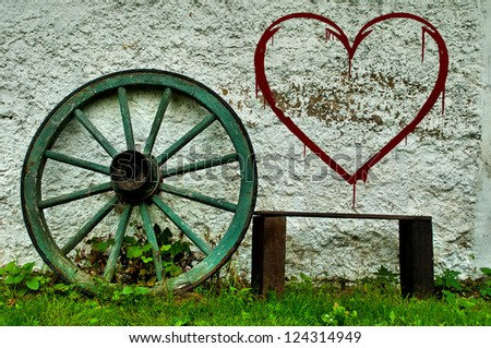 old bench by the wall - stock photo
