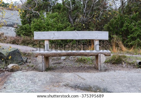 old bench made of rustic wood placed in the nature to rest your body - stock photo