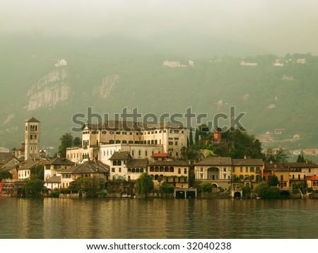 Old Benedictine monastery on Isola San Giulio in Italy - stock photo
