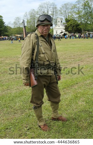 OLD BETHPAGE , NEW YORK - MAY 22, 2016: World War II Encampment participant in World War II American Army uniform in Old Bethpage, NY