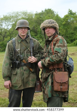 OLD BETHPAGE , NEW YORK - MAY 22, 2016: World War II Encampment participants in World War II German Army uniform in Old Bethpage, NY