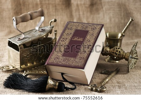 old bible book on vintage background - stock photo