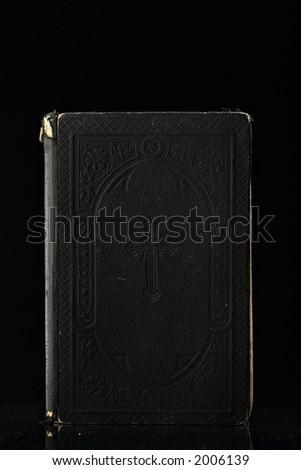 old bible on black - stock photo