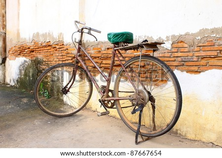 Old bicycle against old wall