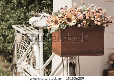 Old bicycle and flowers - stock photo