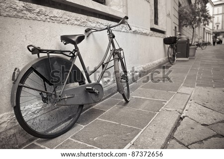 Old bicycle in the historic town center of Mantua, Italy - stock photo