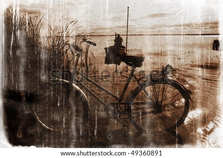 Old bicycle in the reed and lonely fisherman (vintage style, with a grungy effect added) - stock photo