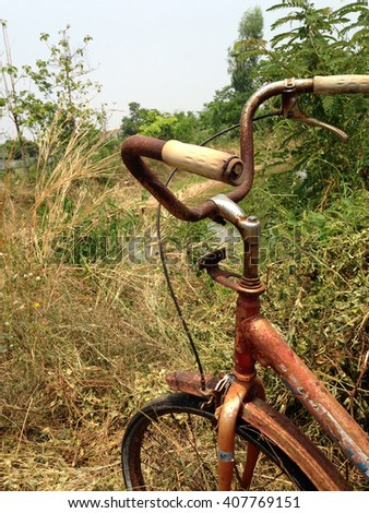 Old Bicycle on the filed