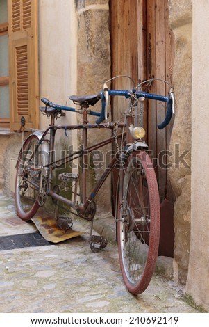 Old bicycle on the street in France - stock photo