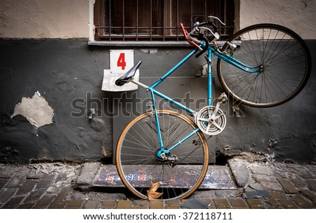 Old bicycle parked in street of Budapest, Europe. Grungy and vintage look. - stock photo
