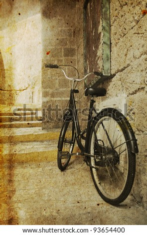 old bicycle. Photo in old image style. - stock photo