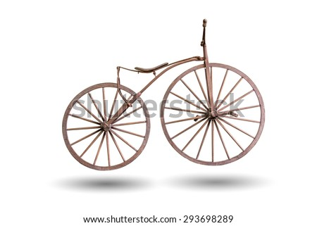 old bicycle with wooden wheels isolated with clipping path - stock photo