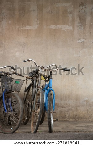 Old bicycles parking outside the repair shop waiting to be fixed. - stock photo