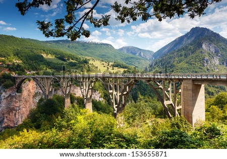 Old big bridge in Durdevica and fantastic view Tara river gorge - is the biggest one canyon in Europe in the national park Durmitor, Montenegro. Balkans. Beauty world. - stock photo