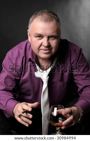 old big man person cognac wicked drink smoke - stock photo