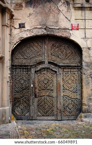 Old big steel doors on a building in Prague. & Old Big Steel Doors On Building Stock Photo (Edit Now)- Shutterstock