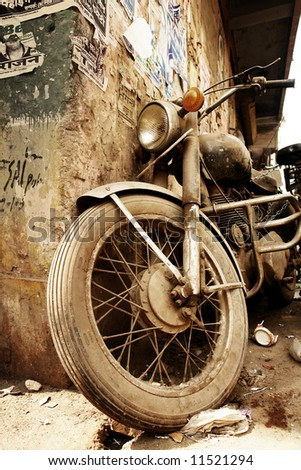 Old bike covered with the sand - stock photo