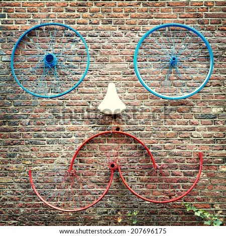 Old bike parts creating a face. Street scene, Amsterdam - stock photo