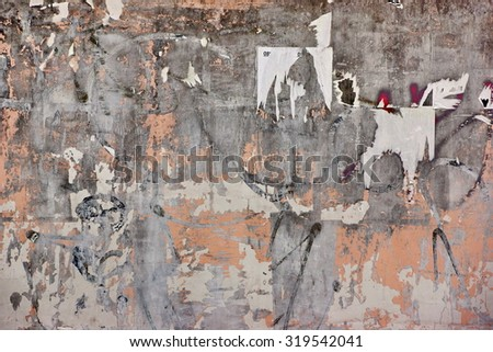 Old Billboard With Torn Posters And Ads  Background Texture Closeup - stock photo