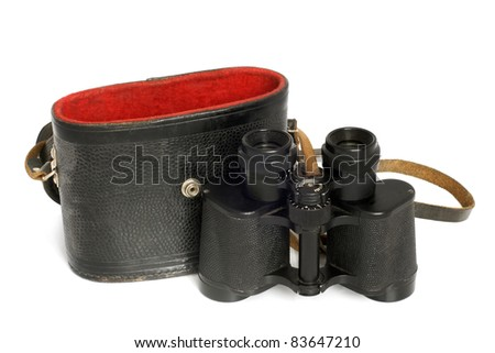 Old binoculars and leather case on a white background - stock photo