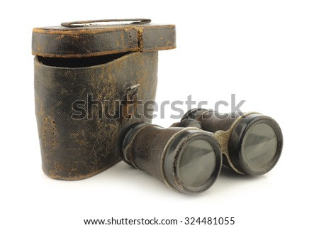 old binoculars with a case on white background - stock photo