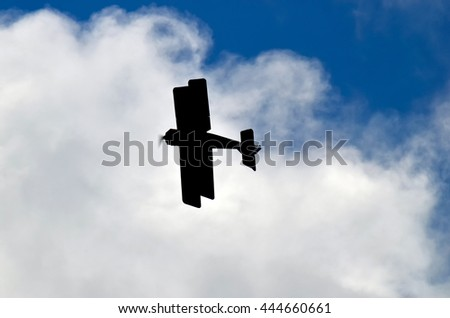 Old biplane airplane flying on sky - stock photo