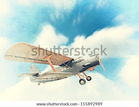 Old biplane in the sky, vintage background - stock photo
