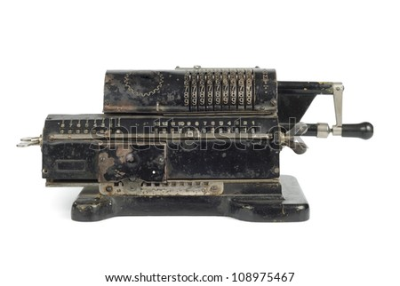 Old black adding machine isolated on white background with clipping path