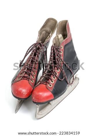 Old black and red hockey skates shot on white background - stock photo
