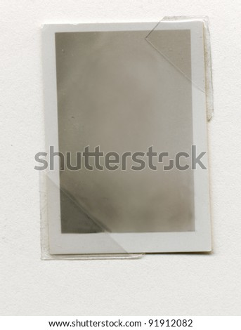 old black and white blank photo paper with a frame - stock photo