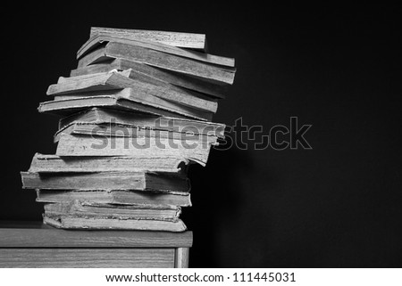 old black and white books pile stack, study concept - stock photo