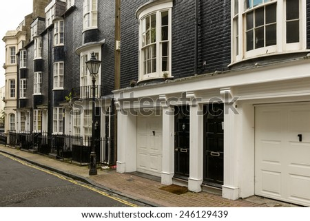 old black and white buildings at Brighton, foreshortening of old black and white houses on a street in touristic sea town,  Brighton, East Sussex  - stock photo