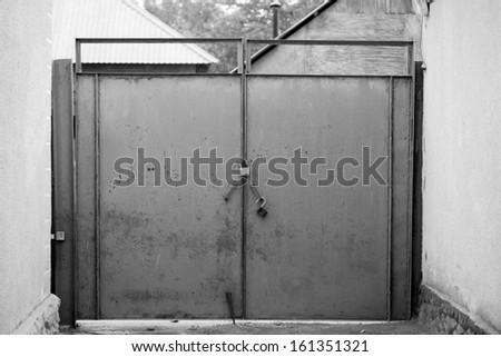 old black and white gates - stock photo