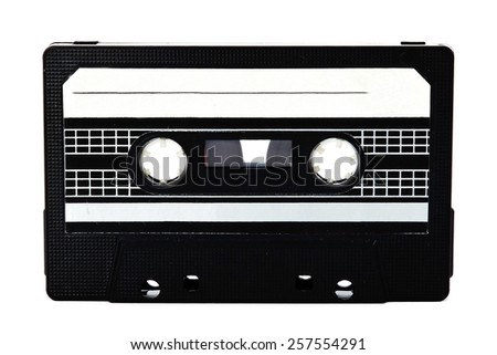 Old black audio cassette isolated on white background - stock photo