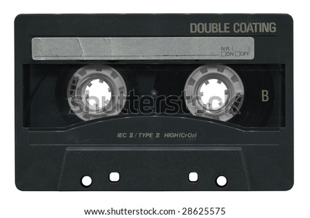 Old black audio cassette with blank label, isolated on white background.