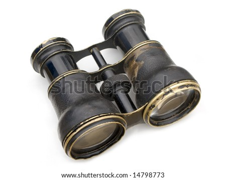 Old black binoculars isolated on white background. - stock photo