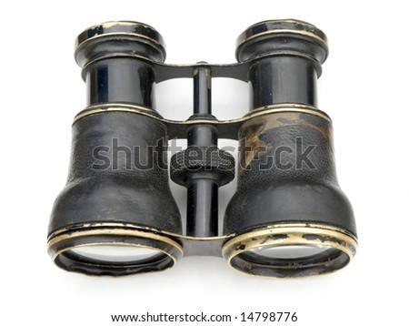 Old black binoculars isolated on white background. - stock photo