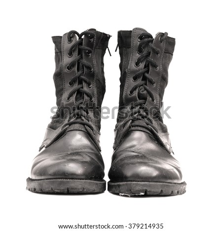 Old black boots on white background.