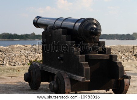 Old Black cannon on the wall over looking the waterway